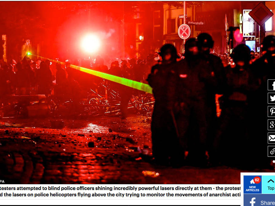 Black-clad anarchists try to blind G20 riot police and helicopter pilots with lasers